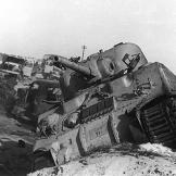 Damaged tank and vehicles, Sinai War, 1956. Watch video of the