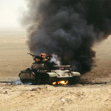 An Iraqi Type 69 tank burns after an attack by the 1st United Kingdom Armored Division during Operation Desert Storm, February 1991. Watch video of the