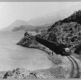 White Pass Railway train on the shores of Bennett Lake, near the Alask