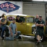 Da Rod Shop crew poses for a group photo in front of a newly restored
