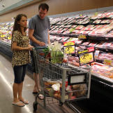 Alan shows Kirlyam a supermarket so she can become accustomed to groce