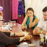 Louis and Aya visit a local bridal salon to find her wedding dress. Th