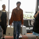 Matt is a huge help to Lizzie and Iva at the airport -- they know noth