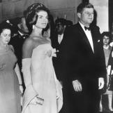 On June 30, 1962, the president and first lady attend a reception in Mexico City. Jackie wears a gown by designer Oleg Cassini.