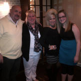 Theresa Caputo with contest winner Tina Maria and her husband and daug