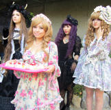 Emily's dolly friends arrive for the tea party.