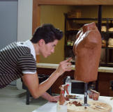 Justin works on his model torso for the six-pack implants he's designing.