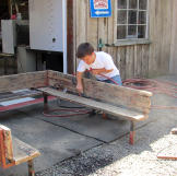 Zach Roloff helps get the benches ready for the wedding.