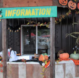 The information booth is festively decorated for Halloween and pumpkin