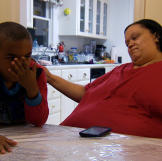 Tara and her son share a moment together at the kitchen table.