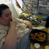 Penny eats a meal in her bed. All of her meals are served by Ed, and h