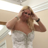 Amanda ordered a custom Pnina Tornai gown with a crystal bodice and tu