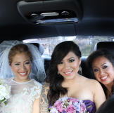Joi is photographed on her wedding day with her niece and sister, who