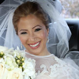 Joi smiles on her wedding day. She's wearing her Something Borrowed dr
