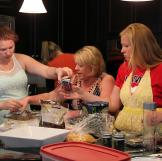 Mykelti, their neighbor Beverly, and Aspyn help prepare party food bac