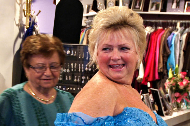 Patti-Anne's mom is a bubbly blond just like the bride. The two are super close. Here, Patti-Anne's mom goes shopping for a mother-of-the-bride dress.