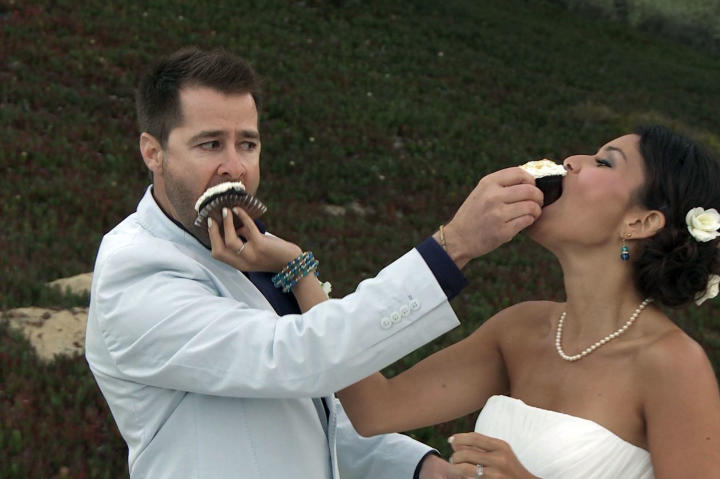 Justin and Evelin aren't shy about smashing a little cake in each other's faces at the reception.