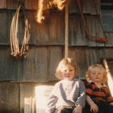 Matt and Bam Bam sit in front of their old cabin as babies. Look at th