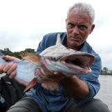 Jeremy with a Dewala Catfish in the Essequibo River in Guyana.