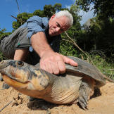 Jeremy captures a freshwater turtle on the banks of the Essequibo Rive