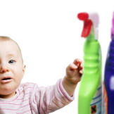 A baby with household cleaners
