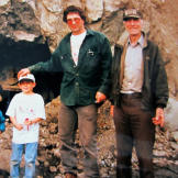 Three generations of Schnabels at Big Nugget: Parker, brother Payson, father Roger and Grandpa John in front of a hard-rock tunnel dug by early miners around 1903.
