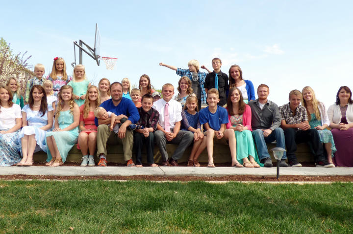 The Williams family poses for a big group photo outside on the lawn.