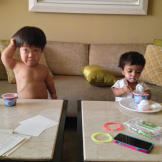 Will and Zoey enjoy some yogurt for breakfast. Will is clearly the nea
