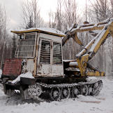 Old Russian log loader. Keeping these machines running is essential.