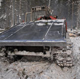 "Old Russian skidder. The continuous track propulsion, also called ""tank tread"" helps the machine move over soft or unstable ground without sinking."