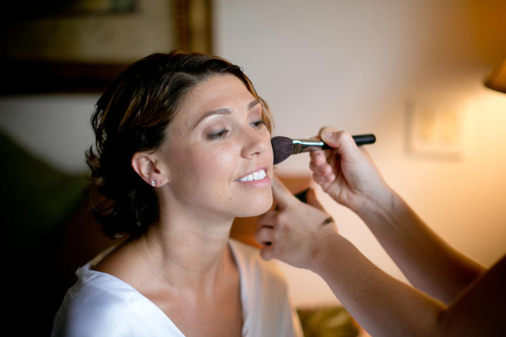 Krista's makeup is professionally applied on her wedding day.