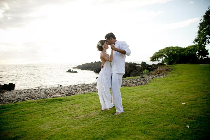 Krista and her husband embrace on a beautiful Hawaiian hillside.