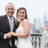 Andrea and Patrick took a moment to pose with the New York skyline behind them.