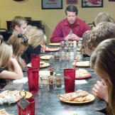 The Duggars give thanks for their meal.