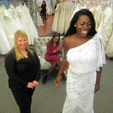 Tohni's reception dress was this one-shoulder beaded gown -- she looke