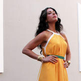 Stacy's look here features a deep yellow that brings out her summer gl
