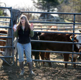 Charlotte Kilcher takes a moment to check on her cattle herd, making s