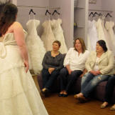 Christen shows her family a classic A-line gown.