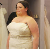 Christen evaluates the strapless neckline on this dress.