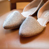 Micah's sparkly wedding shoes.