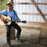 Playing the guitar (Johnny Cash-style) is a welcome respite after muck