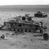 "Damaged German Panzer IIIs in the ""Valley of Death"" near Belhamed, Libya, during Operation Crusader December 1941. Watch video of the"