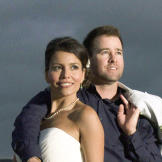 Though they originally planned to elope, the couple is happy they deci