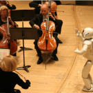 ASIMO can do more than help around the house. Here, ASIMO conducts the Detroit Symphony Orchestra.  Now that you've seen working robots in pictures, think about this: could robots take over? Learn more with our article,