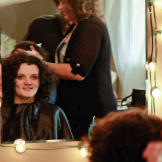 Chapel has her hair styled for the wedding. Curls for this bride!