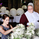 Kate and Mary put the finishing touches on flower arrangements for the
