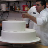 To keep the finished product looking pristine, Buddy coats each cake t