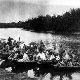 Sea gypsies navigate their boats through a river near Bangkok, Thailan