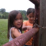 Alexis and Hannah lock the gate to the chicken coop, so the new family