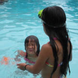 Alexis and Hannah cool off in the pool on a hot day.  Spending time by